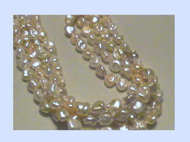 #520 - multistrand white and peach